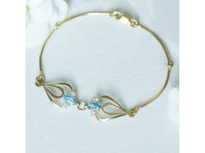 Авторска златна гривна със син топаз и циркони