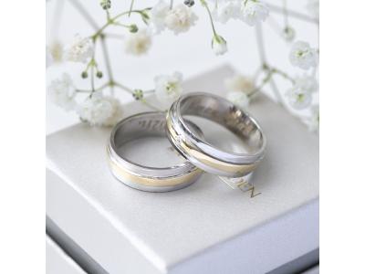 Брачни халки от бяло и жълто злато с камъче